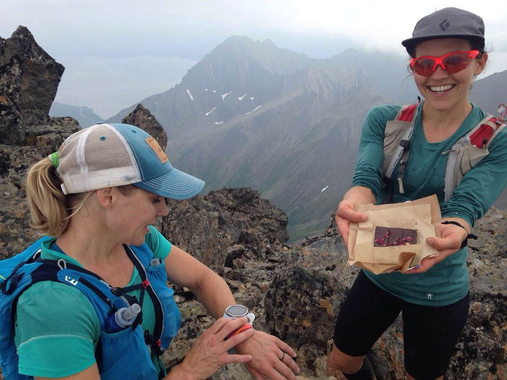 April McAnly, left, checks her watch as Julianne Dickerson displays lavender rose chocolate the climbers ate at the top of 5,065-foot North Suicide. (Photo by Abby Jahn)