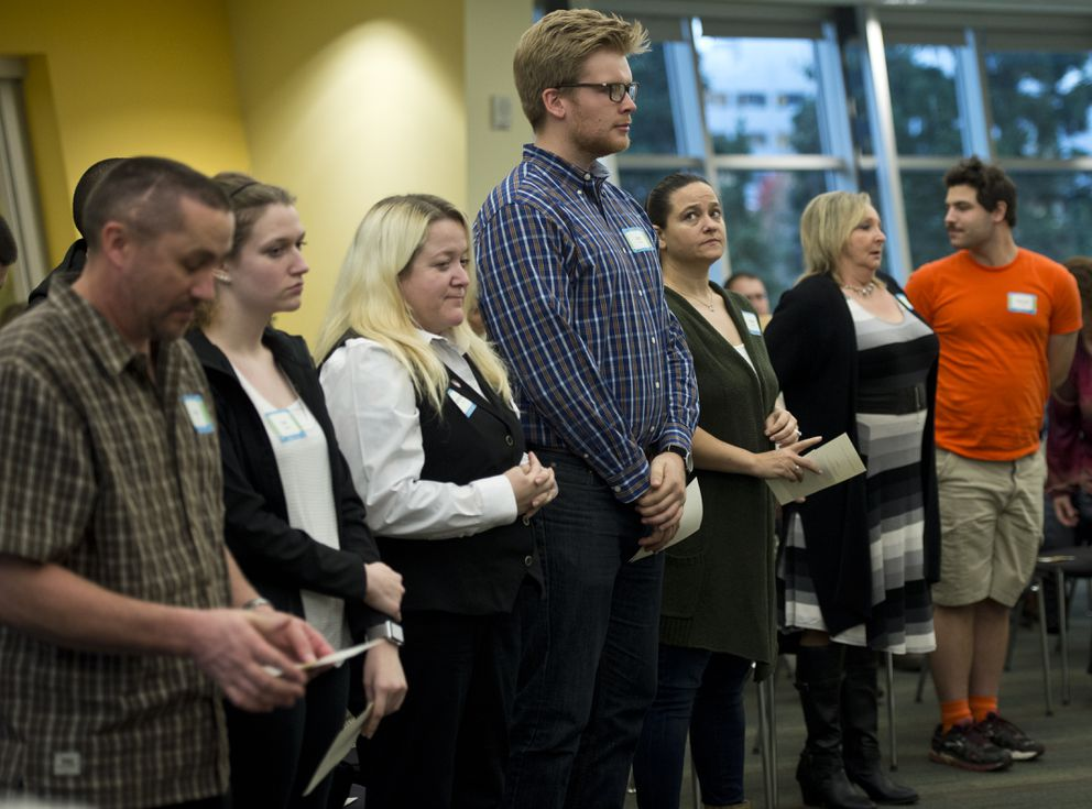 Inductees stand to be recognized during the ceremony, including Zach Christy, center, and Karen Denton, third from right. (Marc Lester / Alaska Dispatch News)