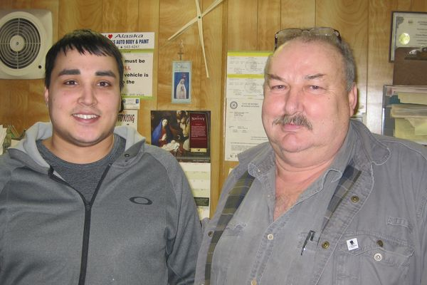 Byron Maczynski, left, collapsed in his father Cezary's auto body shop.