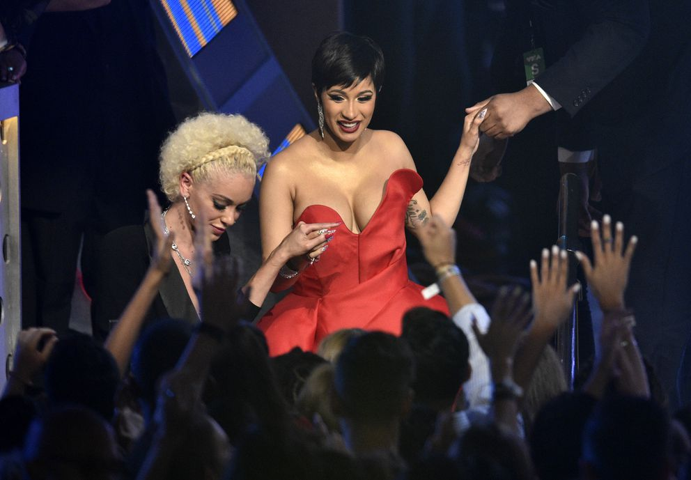 Cardi B, center, walks in the audience to accept the award for best new artist at the MTV Video Music Awards at Radio City Music Hall on Monday, Aug. 20, 2018, in New York. (Photo by Chris Pizzello/Invision/AP)