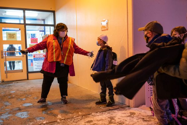 Tudor Elementary principal Nicole Sommerville greets students on the first day of in-person learning Wednesday, Jan. 20, 2021 at Tudor Elementary School. (Loren Holmes / ADN)