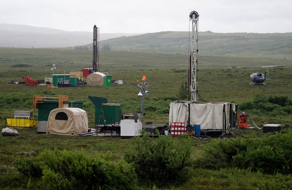 FILE - In this July 13, 2007, file photo, workers with the Pebble Mine project test drill in the Bristol Bay region of Alaska, near the village of Iliamma. T(AP Photo/Al Grillo, File)