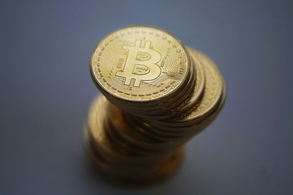 A collection of Bitcoins, a form of cryptocurrency. (Bloomberg photo by Chris Ratcliffe)