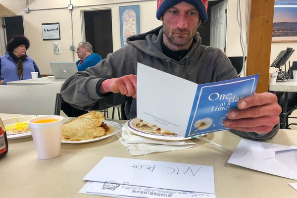 Nicolas Petit reads fan mail Sunday, March 11, 2018 in Unalakleet. (Loren Holmes / ADN)
