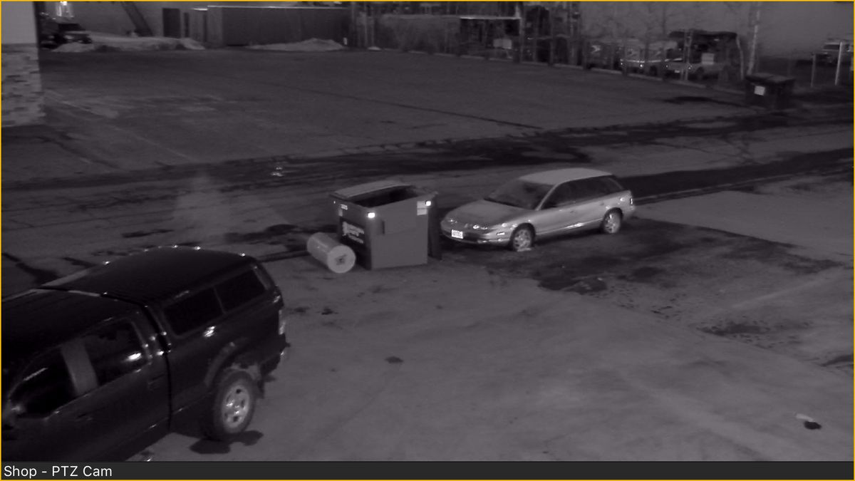 Security camera photos of someone dumping off a water heater at Chad Winberg's A2D Motorsports shop in South Anchorage on Sunday, April 15. (Chad Winberg photo)