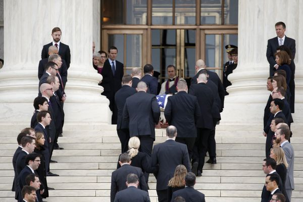 The body of Justice Antonin Scalia arrives at the Supreme Court in Washington on Friday morning. Thousands of mourners are expected to pay their respects as his casket rests in the Great Hall of the Supreme Court.