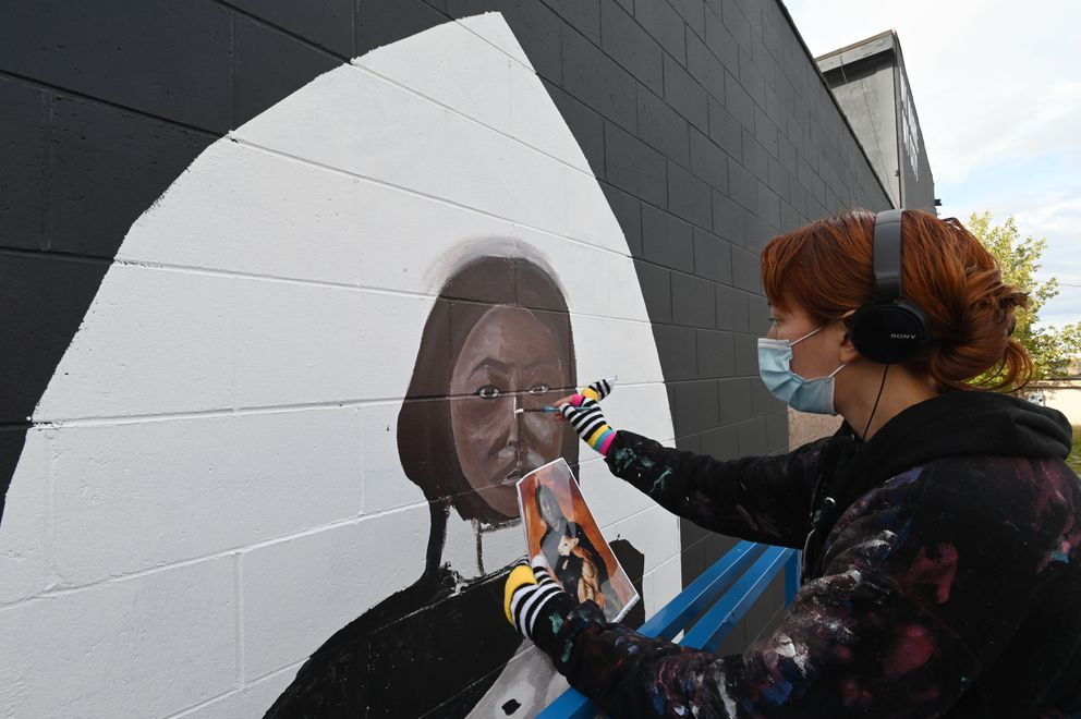 Artist Simone Bethancourt paints 'Protect the Sacred ' which she called 'a modern take on the Lakota story about White Buffalo Calf Woman ' on Monday, Sept. 21, 2020. (Bill Roth / ADN)