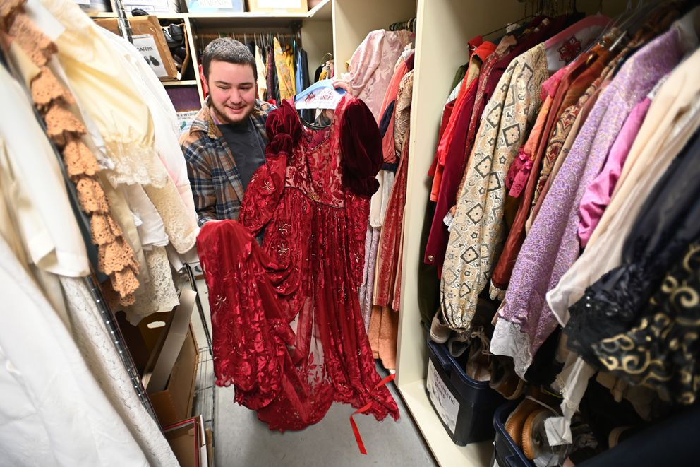 UAA senior Brighton Coggins shows one of the dresses that he designed for the production of 'Romeo and Juliet. ' 'The first time I saw this on stage was the proudest moment of my life, ' said Coggins. 'I'll be able to think about that forever. ' (Bill Roth / ADN)