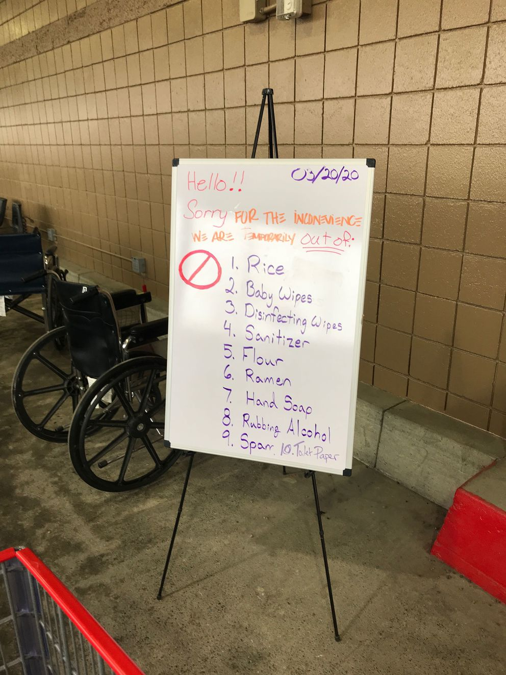 A sign outside the South Anchorage Costco shows items sold out on Saturday, March 20, 2020. (Photo by Linda Hulen)