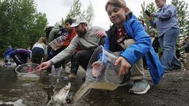 In Anchorage, Fish and Game gets help stocking Cheney Lake with 1,500 rainbow trout