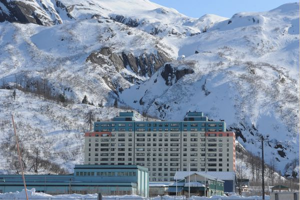 The 14-story Begich Towers in Whittier is dwarfed by surrounding mountains on Monday, March 30, 2020. (Bill Roth / ADN)