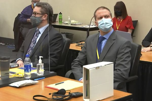In this image from video, defense attorney Eric Nelson, left, and former Minneapolis police officer Derek Chauvin listen as Hennepin County Judge Peter Cahill presides over pre-trial motions prior to opening statements, Monday March 29, 2021, in the trial of Chauvin, in the May 25, 2020, death of George Floyd at the Hennepin County Courthouse in Minneapolis, Minn. (Court TV via AP, Pool)