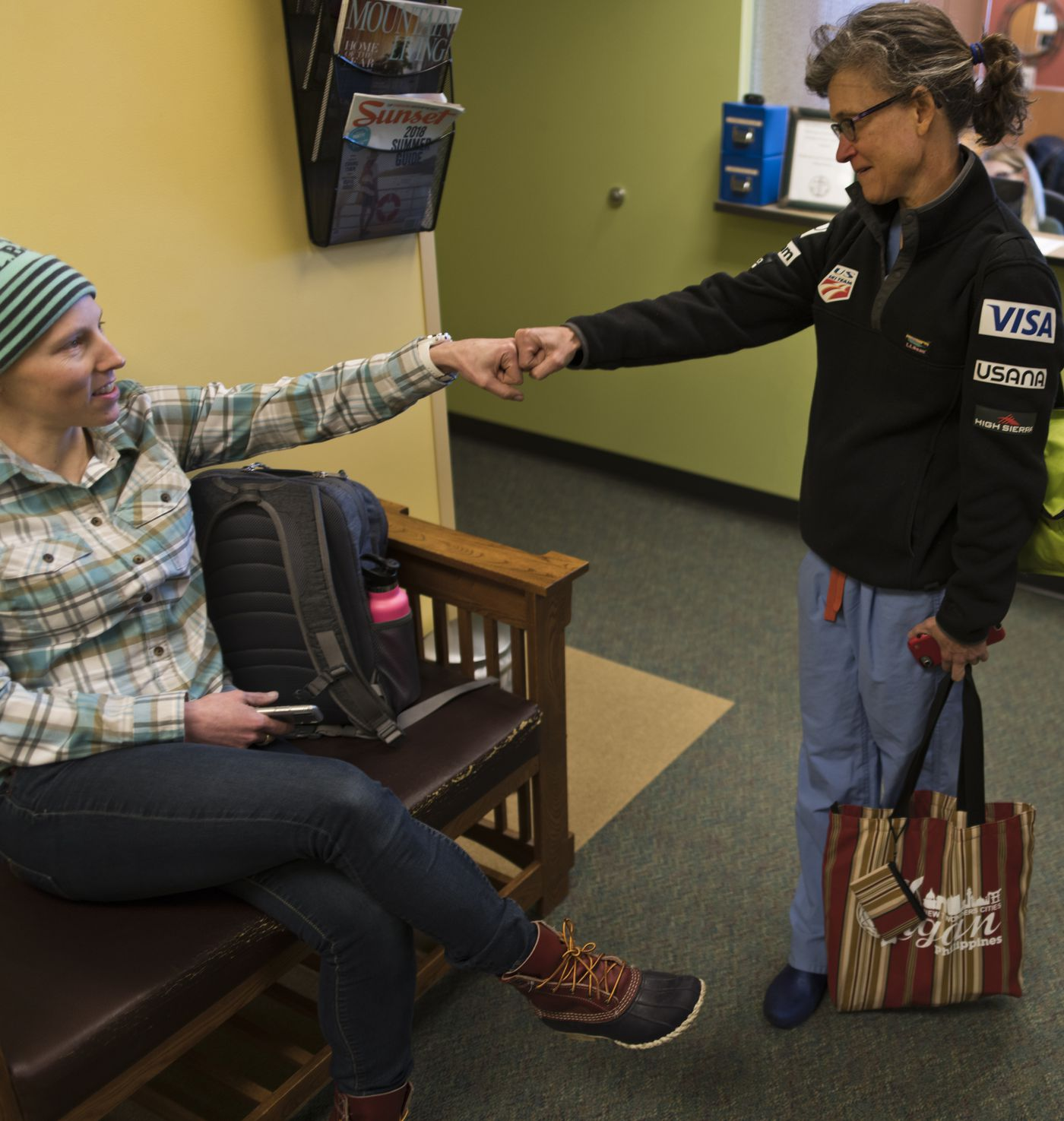 Dr. Marilyn Sandford, a surgical oncologist, gives Kikkan Randall a fist bump after Randall's pathology reports showed a 'complete response ' on Nov. 15. (Marc Lester / ADN)