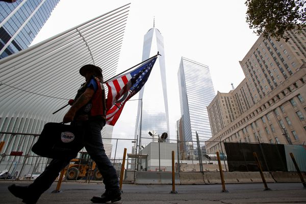 A man arrives at the World Trade Center complex on the morning of the 15th anniversary of the 9/11 attacks in Manhattan, New York, U.S., September 11, 2016. (Andrew Kelly / Reuters)