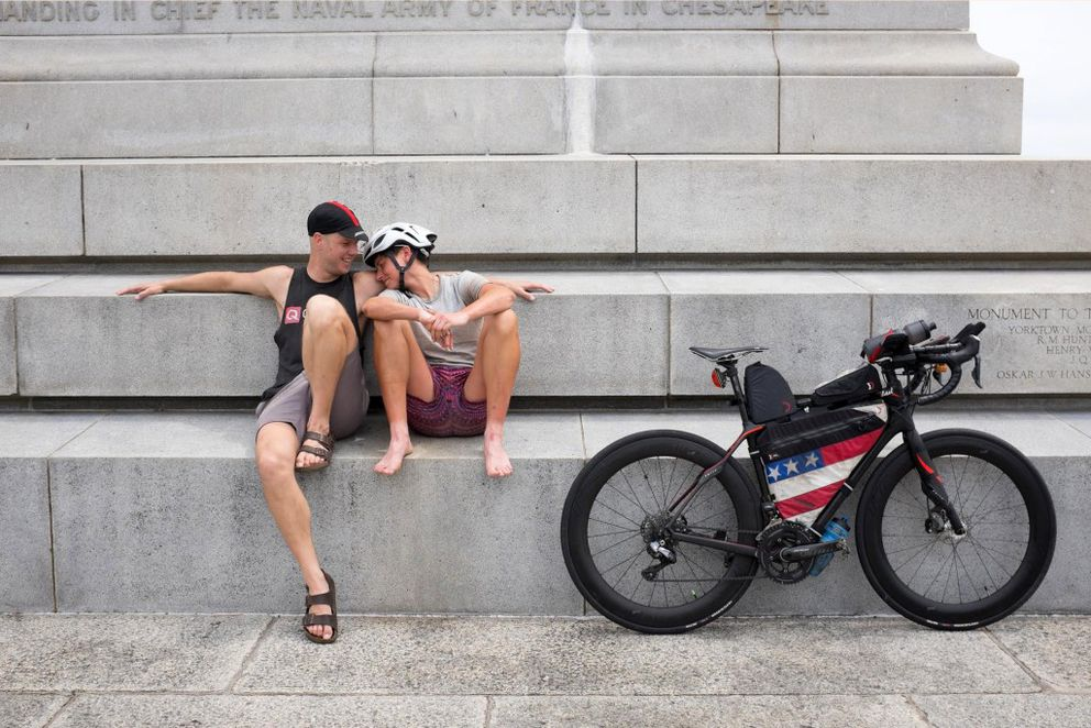 Lael Wilcox relaxes with boyfriend Nicholas Carman at the Yorktown Victory Monument after completing and winning the 4,200-mile Trans Am Bike Race. (Nicholas Carman)
