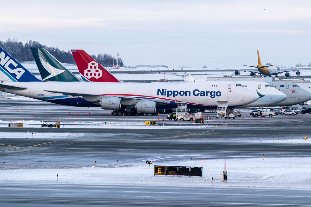 Three Boeing 747 cargo aircraft are parked at the Anchorage International Airport on Wednesday, Dec. 9, 2020. (Loren Holmes / ADN)