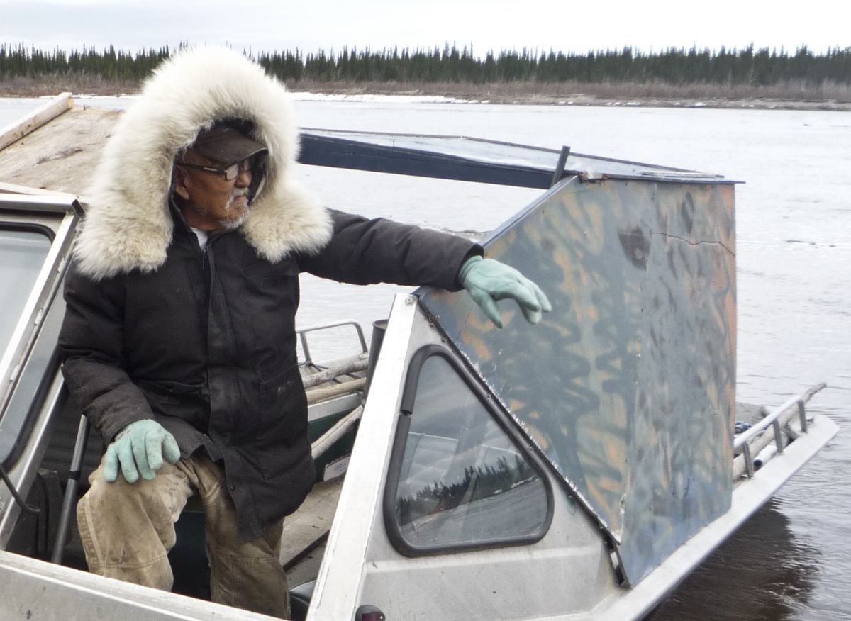 Clarence Wood stands with his boat on the Kobuk River in 2014. (Stacey Glaser)
