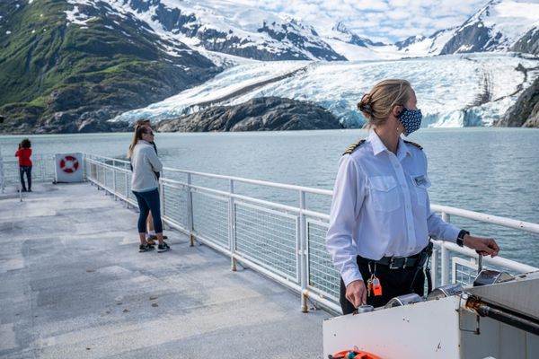 Marcelle Roemmich captains the M/V Ptarmigan on a tour of Portage Lake and Portage Glacier on Saturday, June 13, 2020. (Loren Holmes / ADN)