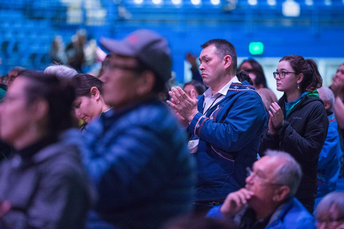 Crawford Patkotak, chairman of the Arctic Slope Regional Corp., applauds after the Presbyterian Church apologized for past abuses made by the church to Alaska Native people, during the Alaska Federation of Natives convention in Fairbanks on Saturday. (Loren Holmes / Alaska Dispatch News)