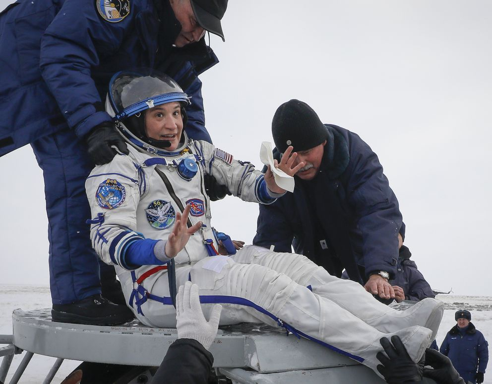 Ground personnel help NASA's Serena Aunon-Chancellor to get out of capsule after landing in a remote area outside the town of Zhezkazgan, formerly known as Dzhezkazgan, Kazakhstan, on Thursday, Dec. 20, 2018. Three astronauts have returned to Earth after more than six months aboard the International Space Station. (Shamil Zhumatov/Pool via AP)
