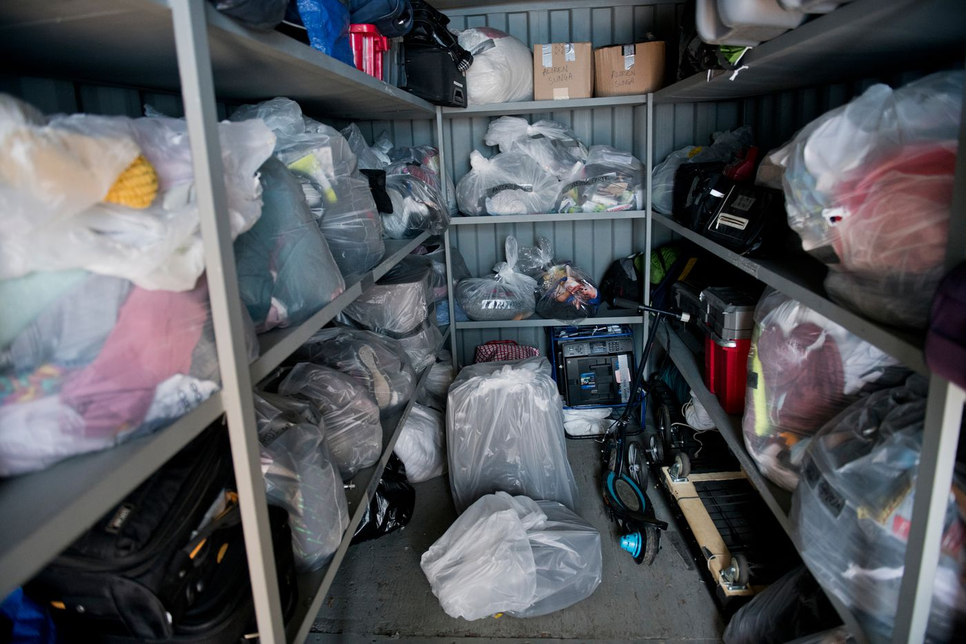 Locked trailers at the Embarcadero SAFE Navigation Center allow for guests to store their belongings. Guests can also store items beneath their beds and in lockers. (Marc Lester / ADN)