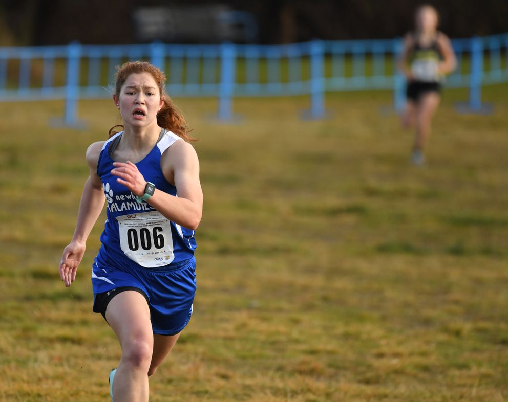 Aileen Lester of Newhalen wins the Division II title with a time of 21:11 at Kincaid Park on Saturday. (Photo by Bob Hallinen)