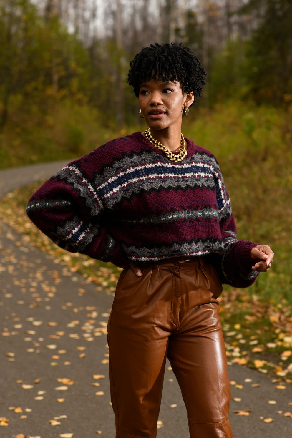Aspen Raney wears '80s high-waisted leather trousers with a knit crewneck sweater. Raney markets vintage clothing through Kuration Collective, her online shopping company. Photographed in Anchorage on October 8, 2020. (Marc Lester / ADN)