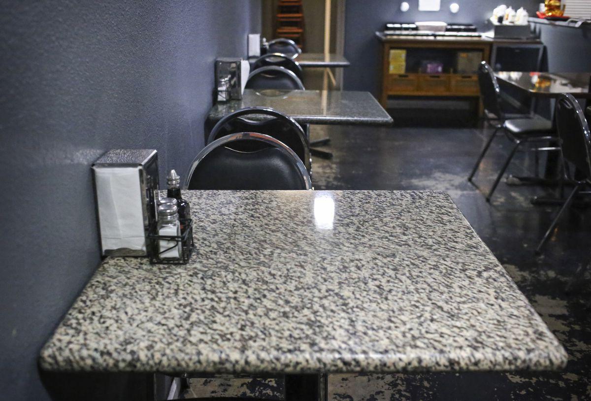 Empty tables line The Hott Spot restaurant in Anchorage on Nov. 18, 2020. (Emily Mesner / ADN)