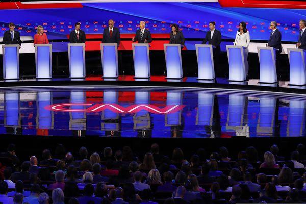From left, Sen. Michael Bennet, D-Colo., Sen. Kirsten Gillibrand, D-N.Y., former Housing and Urban Development Secretary Julian Castro, Sen. Cory Booker, D-N.J., former Vice President Joe Biden, Sen. Kamala Harris, D-Calif., Andrew Yang, Rep. Tulsi Gabbard, D-Hawaii, Washington Gov. Jay Inslee and New York City Mayor Bill de Blasio participate in the second of two Democratic presidential primary debates hosted by CNN Wednesday, July 31, 2019, in the Fox Theatre in Detroit. (AP Photo/Paul Sancya)