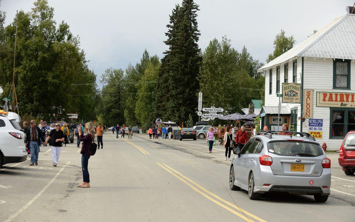 Tourists wander the main street of Talkeetna. (Bob Hallinen / Alaska Dispatch News)