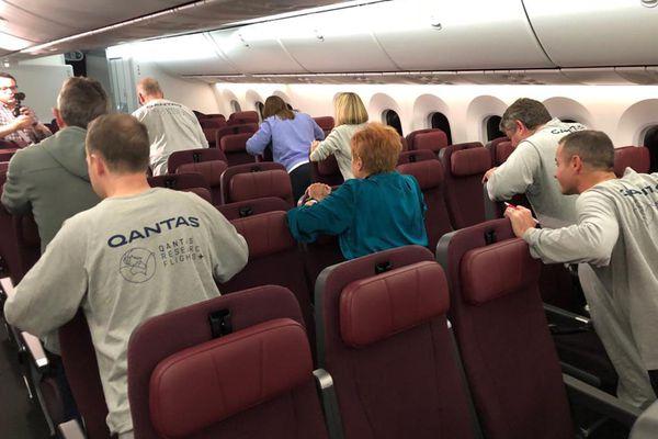 Passengers undertake synchronized exercises mid-flight. (Angus Whitley/Bloomberg)