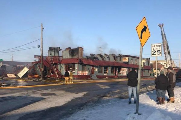 One person was confirmed dead after a fire destroyed the Polaris Hotel in downtown Nome, Alaska, on October 31, 2017. (Photo by John Handeland)