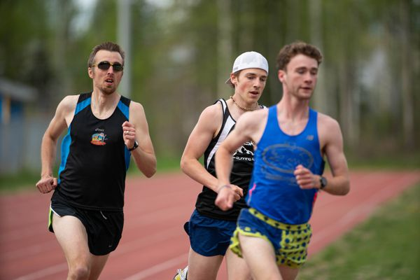 Jake Moe, left, and Tristian Merchant, right, pace Kaleb Smith, center, during a 1600 meter time trial on Wednesday, May 20, 2020 at Bartlett High. (Loren Holmes / ADN)