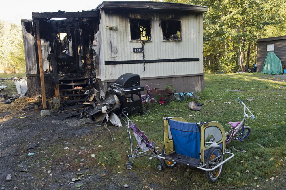 The mobile home in Butte that was destroyed in the fire Sept. 7. Five children died in the fire, which investigators now say was caused by cooking. The girls died from smoke inhalation, authorities said. (Marc Lester / Alaska Dispatch News)