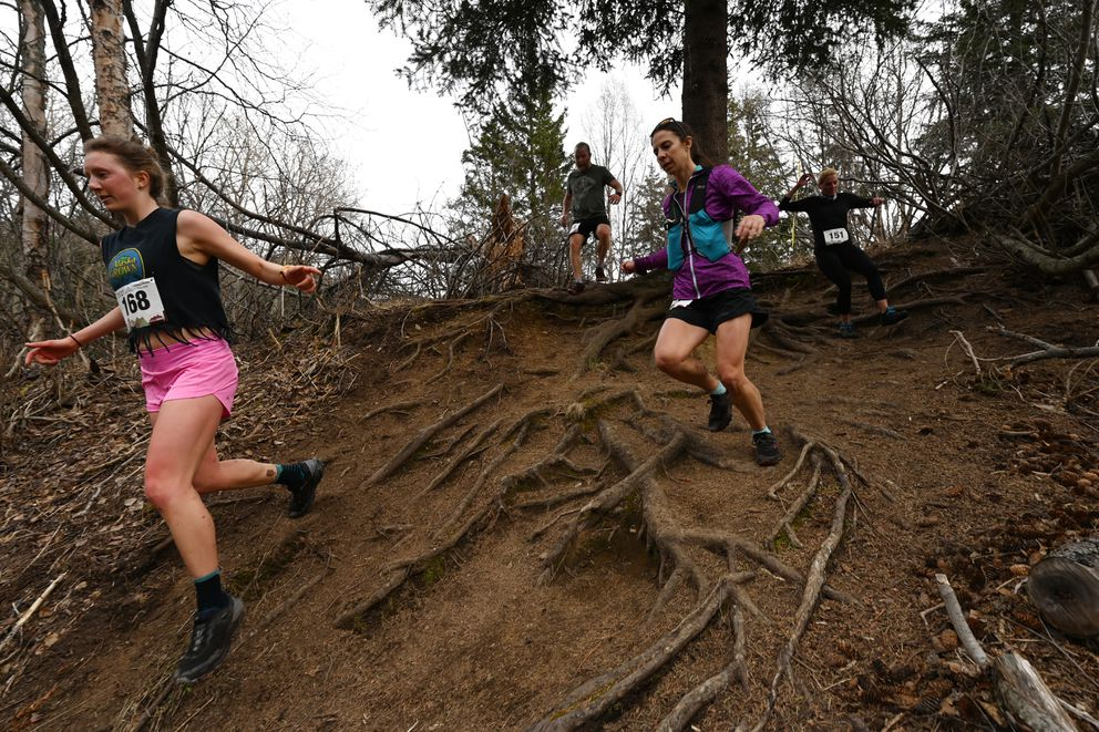 Rachel Topf leads a group of 8-mile racers down a hill with tree roots during the Turnagain Arm Trail Run on Thursday, May 6, 2021. (Bill Roth / ADN)