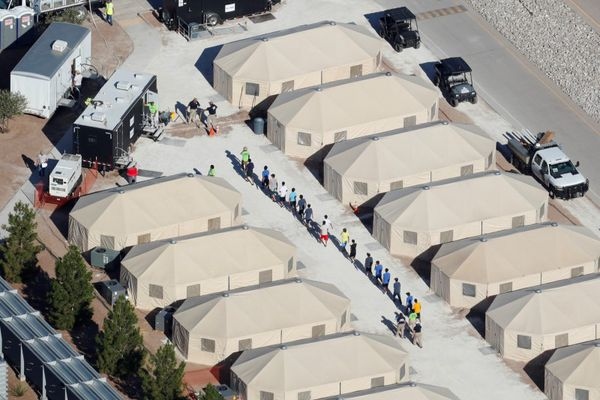Immigrant children now housed in a tent encampment under the new