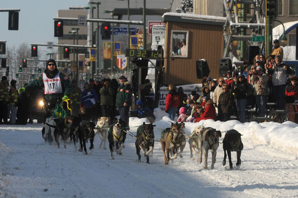 Buddy Streeper leaves the starting line on 4th Avenue at the start of the third day of racing at the 2009 World Championship Sled Dog Races in Anchorage on Sunday, March 1. Streeper made up 2 minutes and 11 seconds on Willow's Bill Kornmuller on the final day to win by nine seconds. Stephen Nowers / Alaska Dispatch News