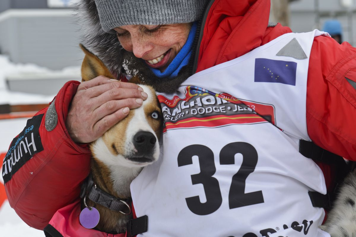 Mille Porsild hugs her lead dogs after placing 15th Wednesday in the first Iditarod Trail Sled Dog Race to win the Rookie of the Year award. (Marc Lester / ADN)