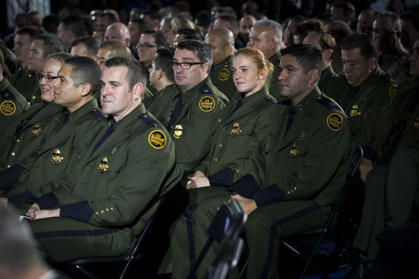 FILE -- U.S. Border Patrol agents listen to President Donald Trump at the Department of Homeland Security in Washington, Jan. 25, 2017. Trump wants to streamline the process to add 5,000 new Border Patrol agents, but critics say cutting corners could again leave the agency vulnerable to corrupt hires. (Doug Mills/The New York Times)