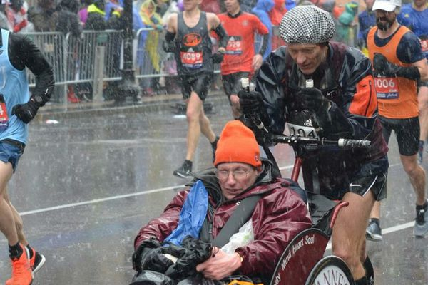 Andy Beardsley and Larson Klingel, of Homer, near the finish line of the 2018 Boston Marathon. Their time of 3 hours and 40 minutes gave them second place in their AWD division. (Photo by Scott Beardsley)