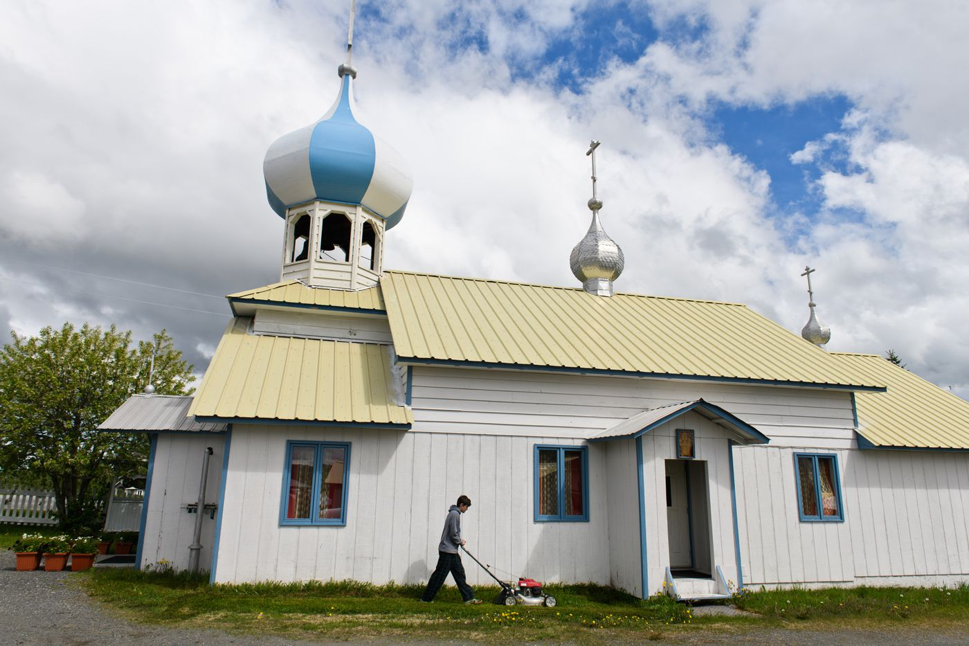 The grass is mowed outside one of two churches in Nikolaevsk. (Marc Lester / ADN)
