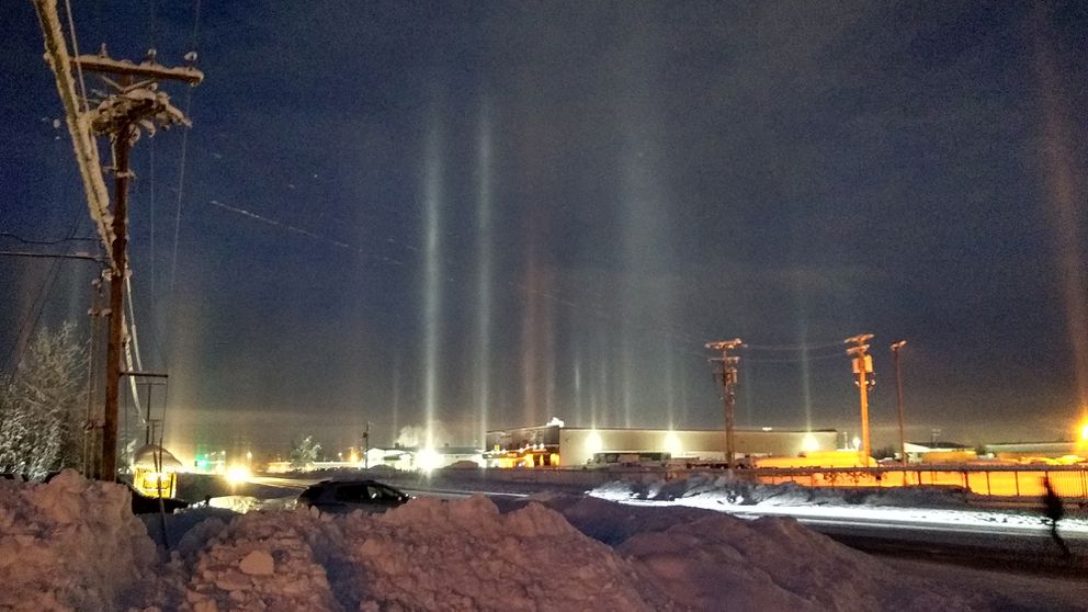 Light pillars appear when falling ice crystals reflect light off their undersides on Feb. 7, 2020, in Fairbanks. (Photo by John Shook)