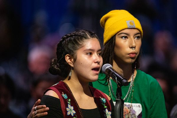 Nanieezh Peter, 15, and Quannah Chasing Horse Potts, 17, speak in support of a resolution reinstating a climate action leadership task force and declaring a state of emergency on climate change, on Saturday, Oct. 19, 2019 during the Alaska Federation of Natives convention at the Carlson Center in Fairbanks. (Loren Holmes / ADN)