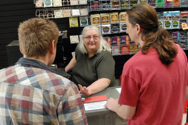 Store owner Sharon Dunckle talks to customers at Mike's Music in Eagle River on Monday, June 3, 2019. The store is closing after 25 years, according to owner Sharon Dunckle. (Matt Tunseth / Chugiak-Eagle River Star)