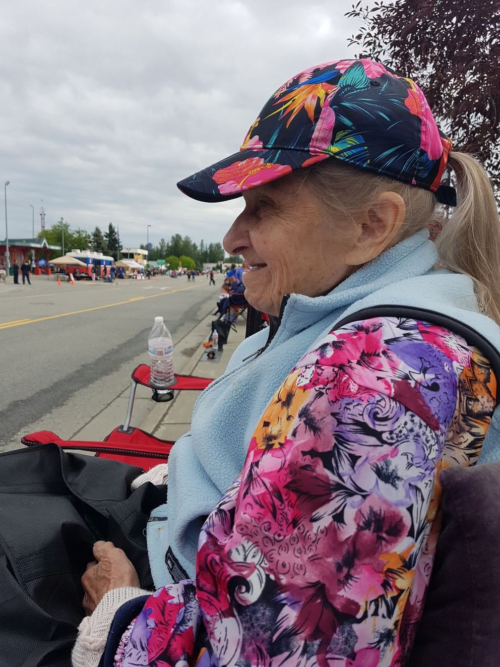 Eagle River's Charlotte Schwid wathces the 2018 Bear Paw Parade in downtown Eagle River. Schwid -- a former WWII Army nurse -- will turn 100 on Wednesday. (Photo by Sharon White/Courtesy)