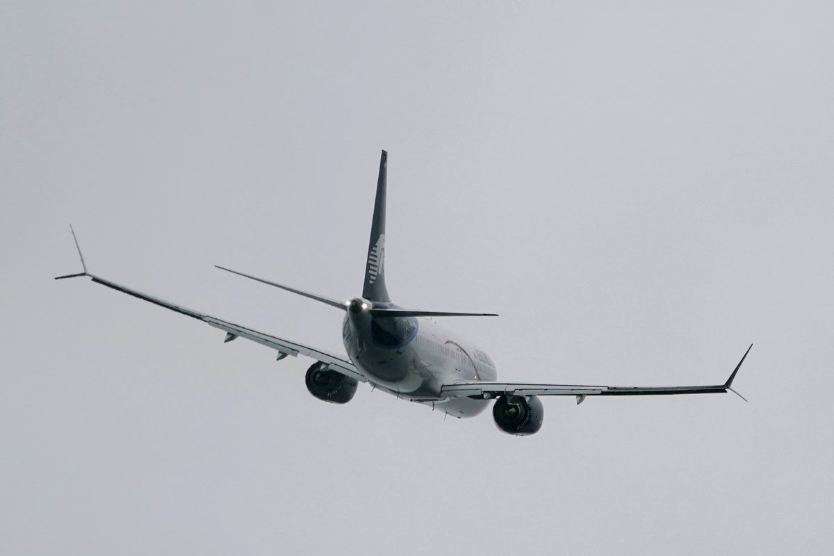 A Boeing 737 Max 9 built for Aeromexico flies after taking off from Renton Municipal Airport, Wednesday, Nov. 18, 2020, in Renton, Wash. After nearly two years and a pair of deadly crashes, the U.S. Federal Aviation Administration announced Wednesday that the 737 Max has been cleared for flight after regulators around the world grounded the Max in March 2019, after the crash of an Ethiopian Airlines jet. (AP Photo/Ted S. Warren)