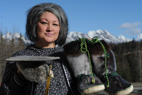 Jacqueline D. Morris displays the sealskin cap and mukluks that her son Tigran Andrew wore during the 2018 Service High School commencement. (Bill Roth / ADN)