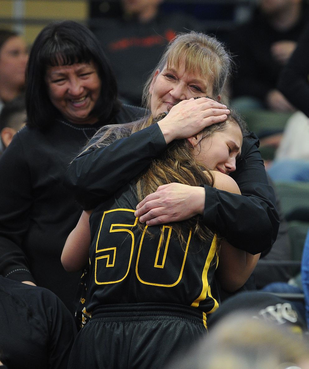 Shelley Yatchmeneff hugs daughter Monica Yatchmeneff after King Cove's state-championship win. (Photo by Bob Hallinen)
