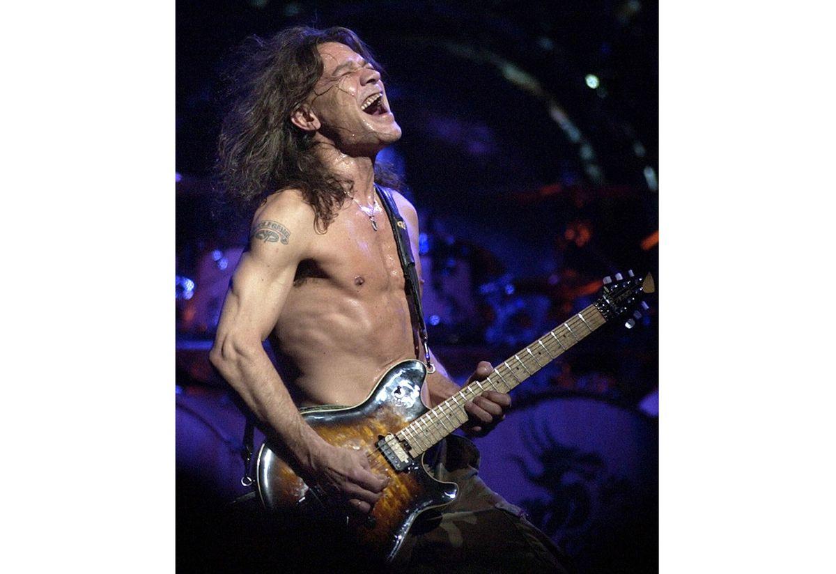 FILE - In this Aug. 5, 2004 file photo, Van Halen guitarist Eddie Van Halen performs in Phoenix. Van Halen, who had battled mouth cancer, died Tuesday, Oct. 6, 2020. He was 65. (AP Photo/Tom Hood, File)