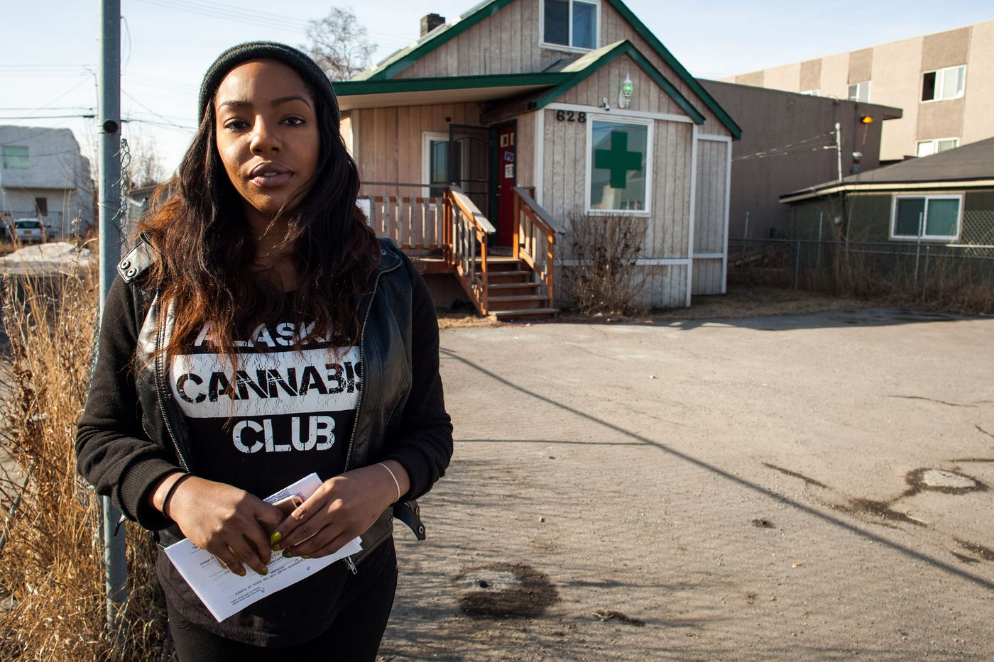 """Alaska Cannabis Club owner Charlo Greene with warrant in hand, said police raided her home around 1 p.m. on March 20, 2015. A statement from Anchorage police later said officers were investigating """"reports of the illegal sale of marijuana and other derivatives"""" at the clubhouse."""